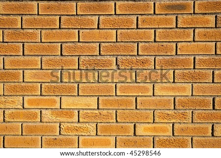 Texture shot of brown colored brick wall