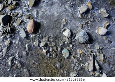 texture stone water ice pebbles #562095856