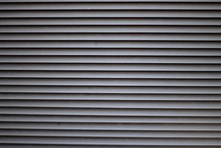 Texture striped background: protective street ventilation metal iron grates, stainless steel grating. Gray blinds, venting