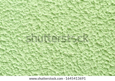 texture, structure of rough decorative rough green, lime putty. monochrome abstract seamless background. copy space, mock up