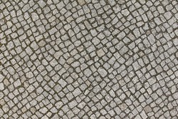 Texture. The area is lined with many small square gray stones