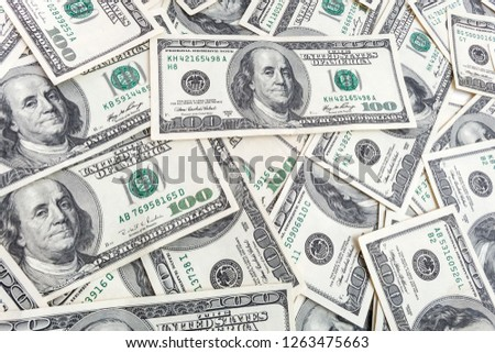 Texture US dollars. Background of one hundred dollar bills.