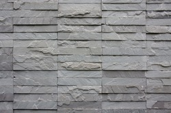 texture wall of gray bricks stone for background