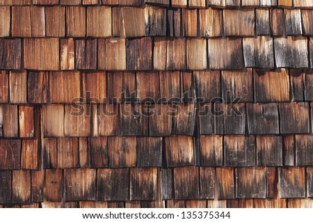 Texture - wooden shingles are tapered pieces of wood primarily used to cover roofs and walls of buildings, Bavaria, Germany. - stock photo