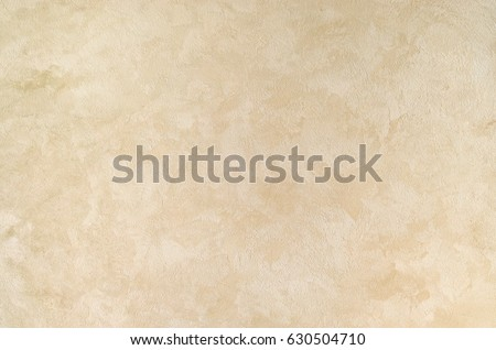 Textured background. Decorative plaster walls, external decoration of facade. Texture of beige. #630504710