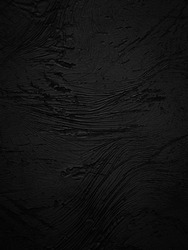 Textured black grunge background. Dark crumpled texture.