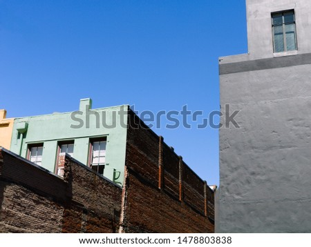 textured building exteriors against a blue sky
