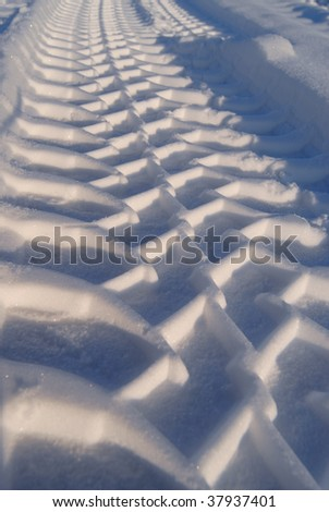 textured car track on snow