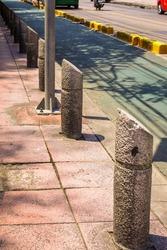 Textured concrete columns on walkway in Bangkok, Thailand