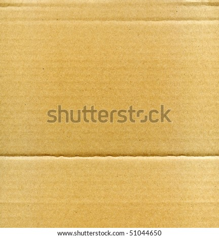 Textured corrugated cardboard with natural fiber parts - stock photo