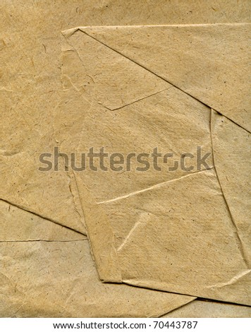 Textured crushed crumpled packaging brown paper background