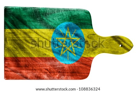 Textured Ethiopia flag painted on old heavily used chopping or cutting board on white background