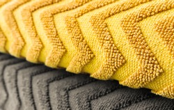 Textured fabric with a zigzag pattern in two colors. Color of the Year 2021. Illuminating Yellow and Ultimate Gray.