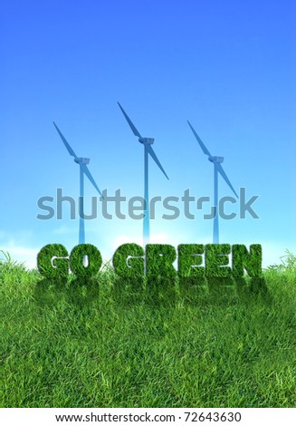 Textured go green sign over fresh grass. Wind turbines over clear blue sky background.