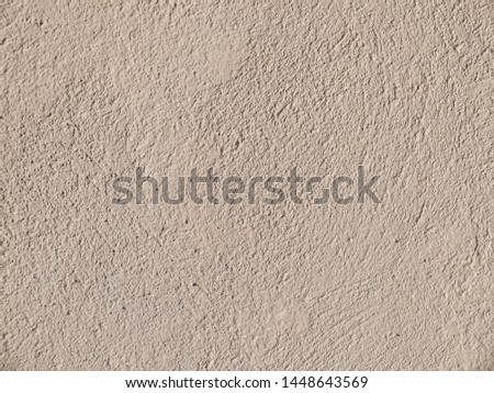 Textured grinded plaster in dark beige. Background or texture seamless pattern #1448643569
