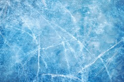 Textured ice blue frozen rink winter background