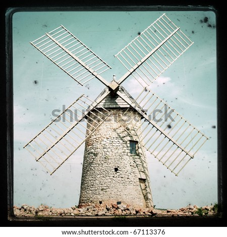 textured image of an old windmill