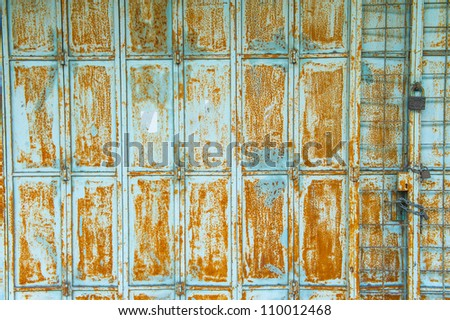 Textured metal wall with stains and rust in Asia