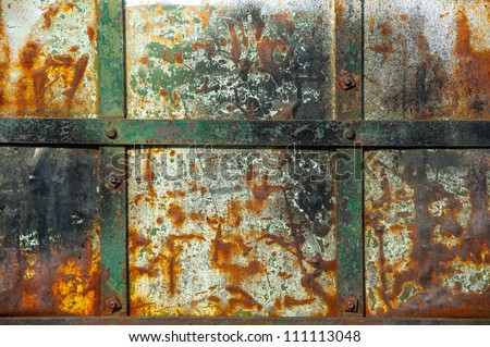 Textured metal wall with stains of rust