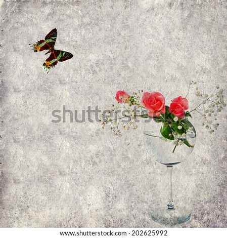 Textured old paper background with flowers in a glass and butterfly. Copy space is available