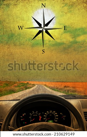 Textured old paper sunshine background with wind rose, wheel and dashboard of a car.  Retro style image