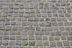 Textured outdoor surface of old masonry made of rough natural stone