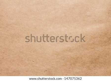 Textured recycled brown vintage paper with natural fiber parts texture background.