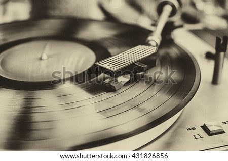 Textured retro image in sepia of vinyl record player. #431826856