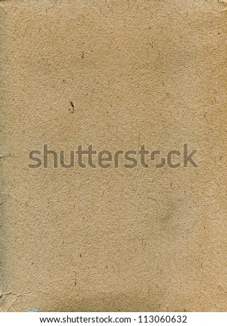 Textured rough grainy recycled paper with natural fiber parts