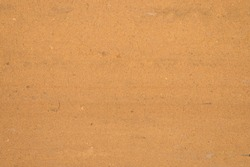 Textured sand surface as background, top view