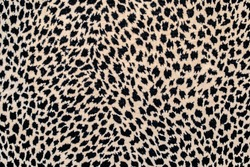 Textured spotted background, repeating seamless pattern of black spots on a beige or yellow background: space for text, leopard skin pattern for fabric