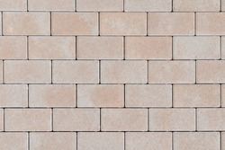 Textured stone wall brick texture abstract background of the Sandstone facade for wallpaper