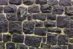 Textured stone wall. Close up of masonry.