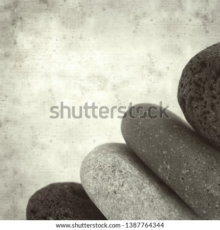 textured stylish old paper background, square, with small zen pyramid of lava pebbles #1387764344