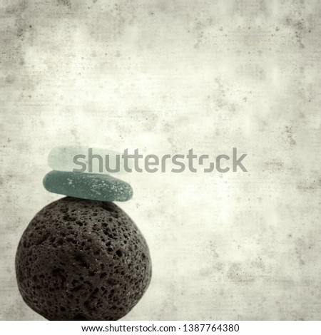 textured stylish old paper background, square, with small zen pyramid of lava pebbles #1387764380
