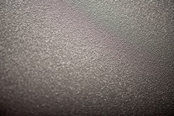 Textured surface of painted metal with powder coating. Fine texture metal surface