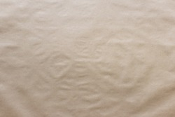 Textured uneven kraft paper background with uneven surface.