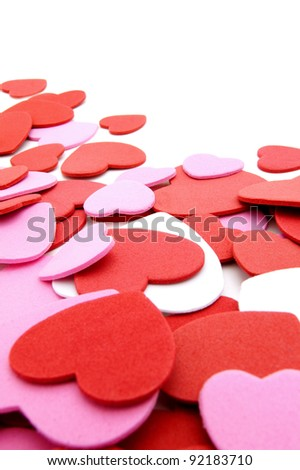 Textured Valentines Day heart-shaped confetti background or border