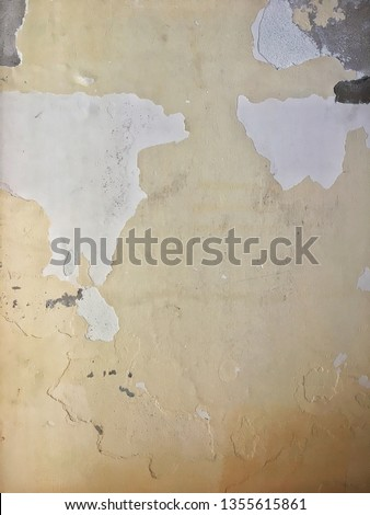 Textures of peeling paint on ancient wall looking like a map or painting
