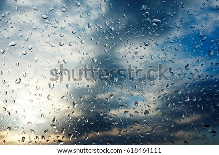Textures of water droplets of rain flow down the window panel. Condensation, high humidity. Natural background