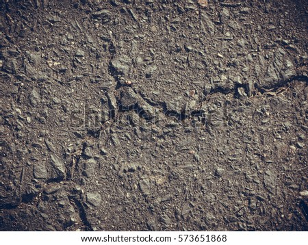 Textures, patterns and backgrounds concept. Grey clay, concrete wall with cracks and inequalities #573651868
