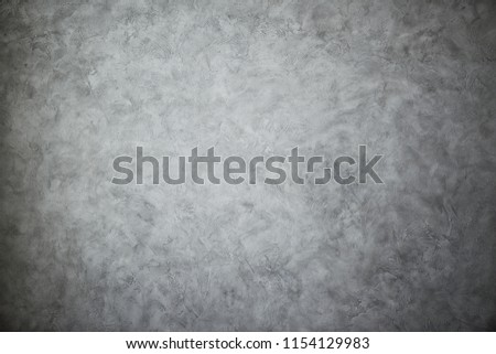 Texturized grey putty. Vintage or grungy background of venetian stucco texture as pattern wall. #1154129983