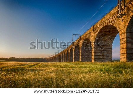 Th Almond Valley Viaduct, also known simply as the Almond Viaduct or the Ratho Viaduct, carries the main Edinburgh to Glasgow line across the River Almond in 36 impressive archways.