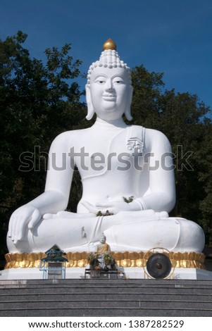Tha Ton Thailand, steps leading up to altars in front of giant white Buddha #1387282529