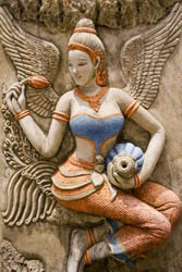 Thai ancient stone carving color lady