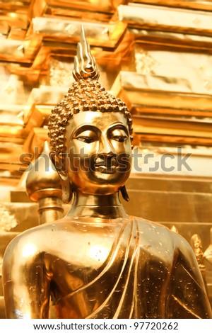 Thai art gold Buddha statue in Chiang Mai of Thailand.