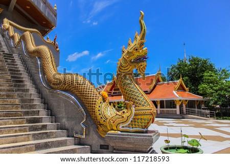 Thai Art, Single Naka statue on staircase balustrade at Thai Buddhist pagoda, Udornthani province, Northeast, Thailand