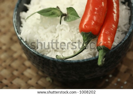 Thai Asian cuisine: Asian diet comprising of red chillies and fluffy jasmine rice  in a basket tray
