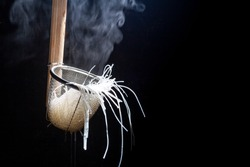 Thai Asian Street Food on rowing boat, fresh white rice Noodle Blanched in Noodle strainer basket wood handle with steam and smoke , junk food concept