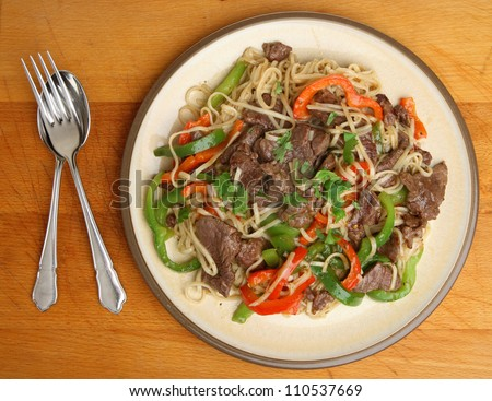 Thai beef and pepper noodle stir fry dinner.